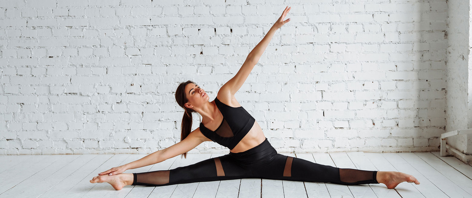 Image of woman doing a split